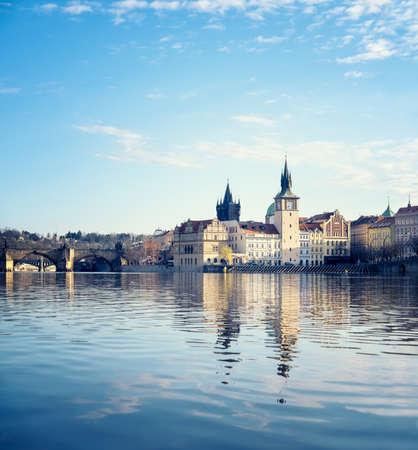 Charles Bridge and Historical buildings in Prague from across Vltava river
