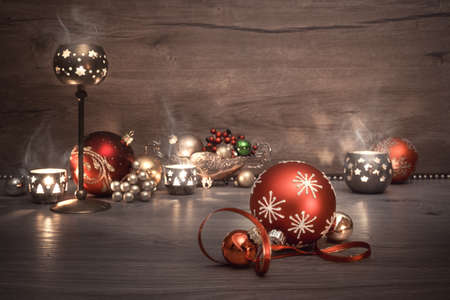 Vintage Christmas background with candles and Christmas baubles, caption Merry Chistmas!. This image is toned. Shallow DOF, focus on the front baubles.