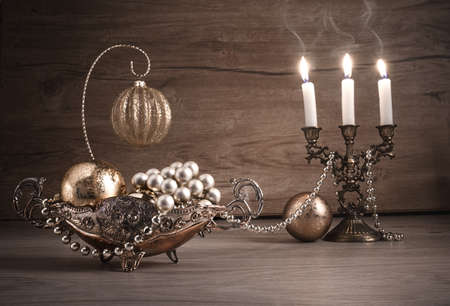 glass table: Vintage Christmas decoratons on wood, this image is toned. Shallow DOF, focus on the ornate dish on the left.
