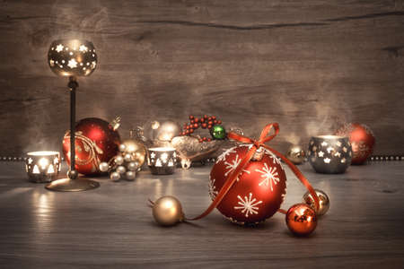 Vintage Christmas background with candles and Christmas baubles, text space. This image is toned. Shallow DOF, focus on the front baubles. Stock Photo