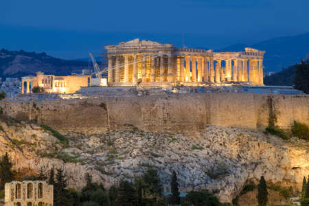 Parthenon and Herodium construction in Acropolis Hill in Athens, Greece, illuminated in the evening