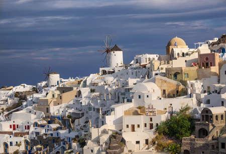 dramatic sky: Oia village on Santorini island, Greece, under dramatic sky