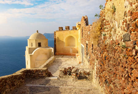 oratoria: Byzantine Castle Ruins in Oia village, Santorini, Greece, early in the morning