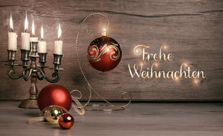 frohe: Stil life with Christmas decorations on wood, caption Frohe Weihnachten on toned image Stock Photo