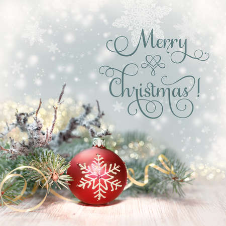 Christmas tree and red bauble, text Merry Christmas on abstract winter background. This image is toned. Stock Photo