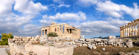 parthenon: The Acropolis of Athens, panoramic image with Erechtheion and Parthenon temples under dramatic sky.