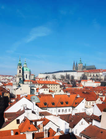 nicolas: St. Nicolas church, Prague castle and and roofs of old town on a bright day, panoramic image, space for your text