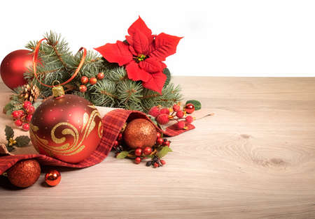 Wooden background with poinsettia and decorated Christmas tree twigs, text space Stock Photo