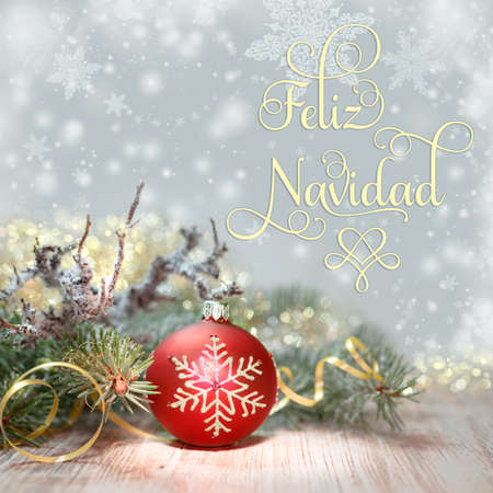Decorated Christmas tree and red bauble, text Feliz Navidad, or Merry Christmas in Spanish