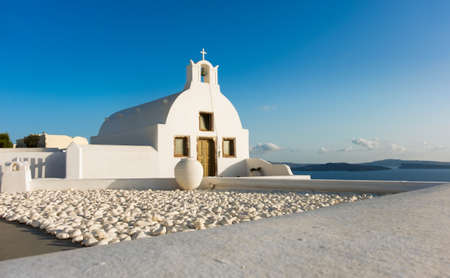 thera: Viewing point next to local Orthodox Church in Oia, Santorini island, Greece.