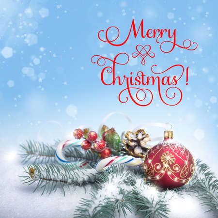 Christmas arrangement on abstract winter background, text Merry Christmas