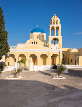St George Church, or Ekklisia Agios Georgios church in Oia village on Santorini island, Greece Stock Photo