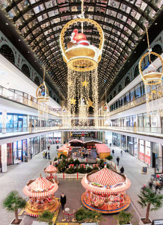 illuminations: BERLIN, GERMANY - DECEMBER 21, 2016: Christmas illumination in Mall of Berlin shopping center in Leipziger Platz in Berlin, panoramic image Editorial
