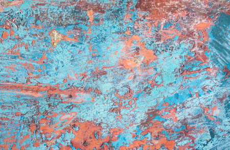 Grunge texture, several layers of paint peeling from fibegrass surface of a boat hull