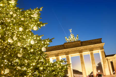 quadriga: Berlin, Christmas tree in front of Brandenburg gate in the evening