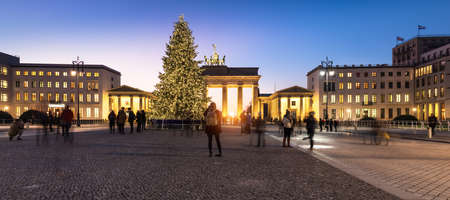 BERLIN, GERMANY - DECEMBER 21, 2016: Panorama of Branderburger Gate in evening illumination with Christmas tree in front. Life in the capital is going back to normal two days after the terror attack on the Christmas market.