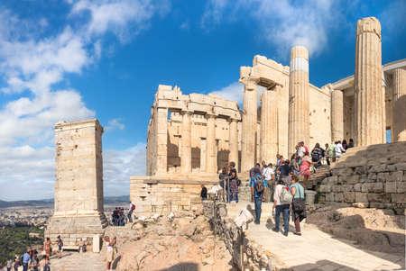 ATHENS, GREECE - OCTOBER 20, 2016: Tourists enter Acropolis fortress through an ancient gateway Propylaea in Athens, Greece. Editorial