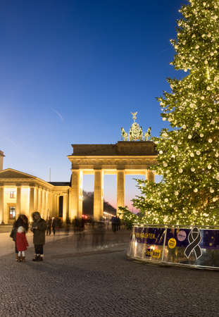 quadriga: BERLIN, GERMANY - DECEMBER 21, 2016: Panorama of Branderburger Gate with black ribbon sigh on the base of Christmas tree. Life in the capital goes back to normal two days after the Christmas market attack. Editorial