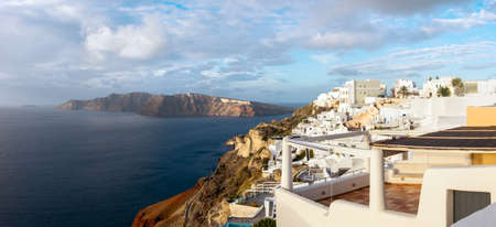Santorini island in Greece, Oia village on misty morning. Panoramic image, space for your text Stock Photo