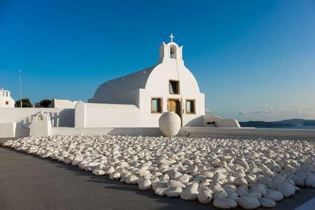 dome of the rock: Santorini island in Greece, Chapel in Oia village at the edge of volcanic caldera