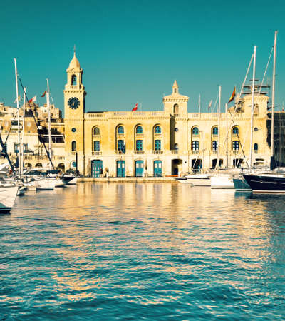 creek: The yachts and boats moored in the harbor in Dockyard creek in front of Malta Maritime Museum. Vittoriosa, Malta. This image is toned.