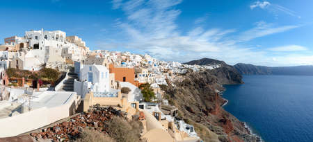 Santorini island in Greece, Oia village on a bright day, panoramic image.