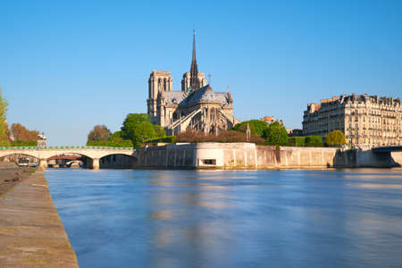 Paris, view over river Seine with Notre-Dame cathedral from the back on a bright day in Spring.