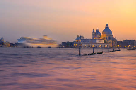 Cruise ship going past Santa Maria della Sallute on a sunset in Venice, Italy Stock Photo