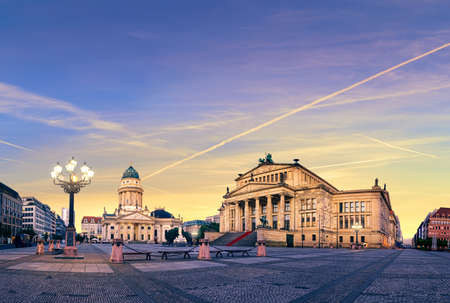 square image: Panoramic image of Gendarmenmarkt square in Berlin with German church and Concert Hall on a sunset. This picture is toned