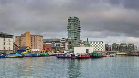 Modern part of Dublin Docklands or Silicon Docks after heavy rain. Panoramic image. Stock Photo