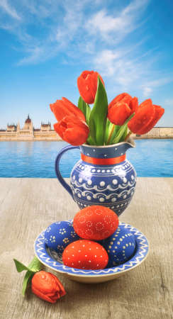 oudoors: Case with tulips and painted Easter Eggs oudoors in Budapest, Hungary Stock Photo