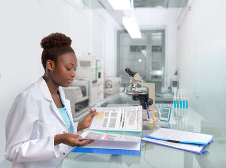 biotechnology: African scientist, medical worker, tech or graduate student works in modern biological laboratory