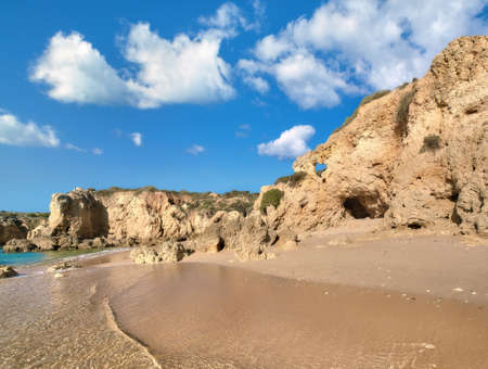romance sky: Golden beaches and sandstone cliffs near Albufeira, Portugal, panoramic image