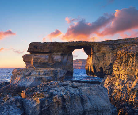 azure coast: Azure window, natural stone arch by Dwejra cliff, Gozo island, Malta on a sunset. The arch had recently collapsed into the sea during storm. This picture is toned.