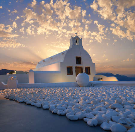 Sunset over local church in Oia village, Santorini island, Greece Stock Photo