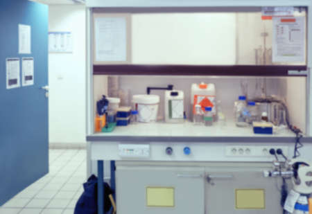 Scientific background: blurred interior of laboratory fume hood in modern laboratory. This is defocused background image, no focus point here. Can be used as a background for your presentation.