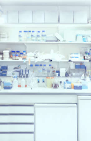 no image: Scientific background: blurred interior of chemodern laboratory. This is vertical defocused background image, no focus point here.  Stock Photo