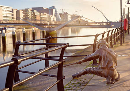 The Linesman statue at Liffey river in Dublin, Ireland, panoramic image