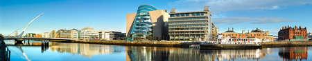 liffey: DUBLIN, IRELAND - FEBRUARY 4, 2017: Panoramic image of Convention Centre Dublin (CCD) and Samuel Beckett Bridge over the river Liffey.