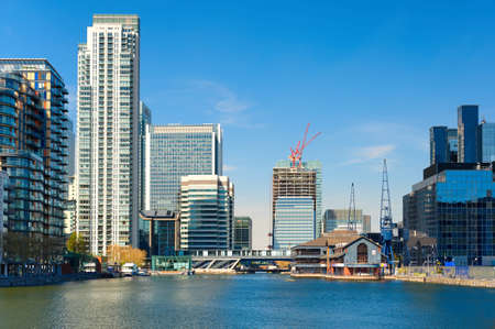 LONDON, ENGLAND - MAY 3, 2013: Canary Wharf skyline and South Dock, East London, England