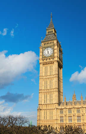 sightsee: Big Ben tower in London with blue sky and clouds behing