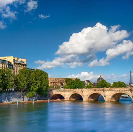 Pont Neuf bridge on Seine river in Paris, France, on a bright sunny day. Long exposure to polish water.