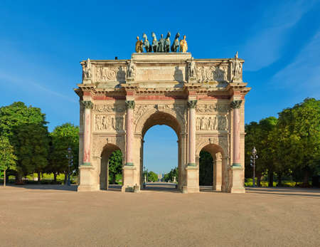 Arc de Triomphe du Carrousel, a monument situated between Louvre Museum and grounds of Tuileries Gardens. Front view with Concorde spire visible through the arch. Editorial