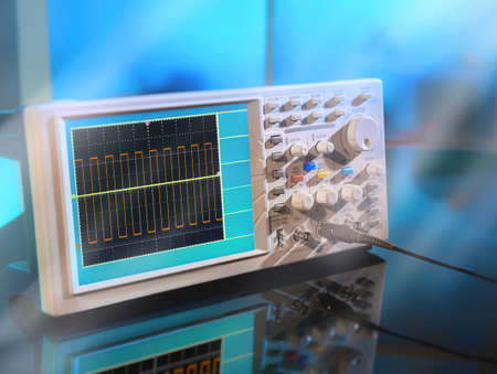 Modern electronic oscilloscope on abstract background. This image is toned