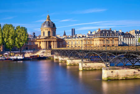 pont des arts leading towards institut de france paris france