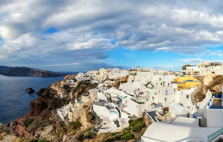 Santorini island in Greece, Oia village, day after the storm. Panoramic image. Stock Photo