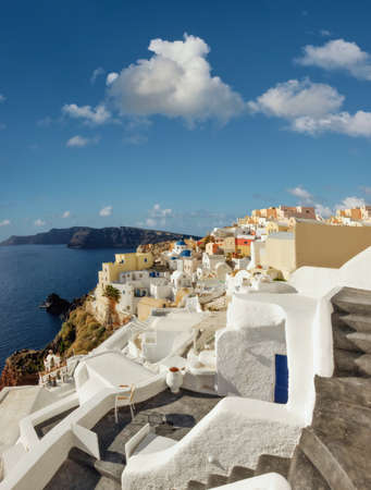 Santorini island in Greece, Oia village on a bright afternoon. Panoramic image.