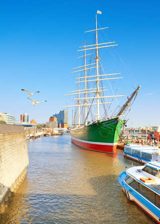 riverbank: HANBURG, GERMANY- AUGUST 13, 2015: Historical sailing ship Rickmer Rickmers in Hamburg. It is a three masted barque, nowadays a museum ship.