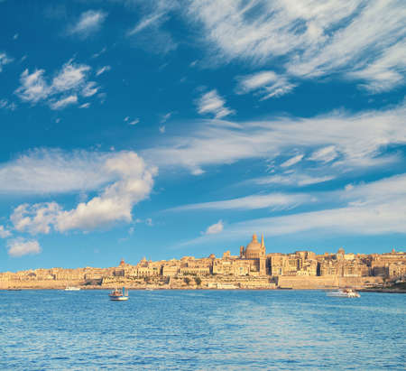 Malta, Valetta, cityscape. Ancient fortifications of La Valetta, old houses and St. Pauls Cathedral. Stock Photo