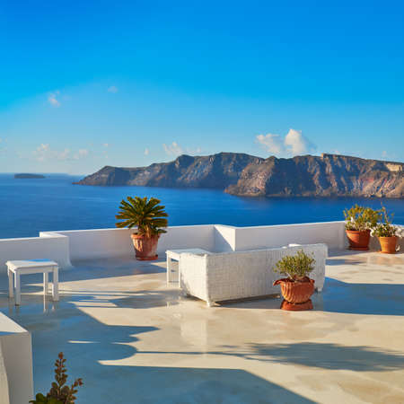 square image: A view of beautiful sea and caldera with luxury roof terrace, typical white architecture of Santorini island, Greece. Panoramic image, square composition Stock Photo